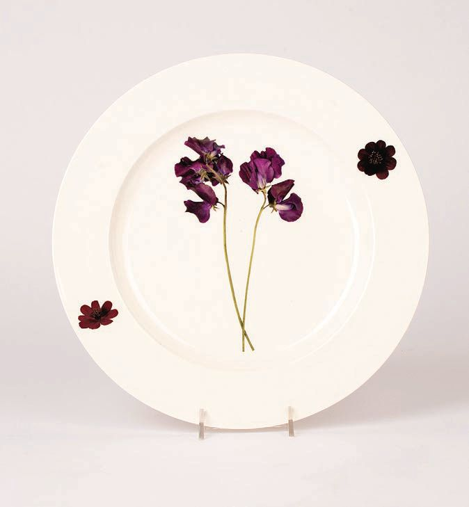 """""""These Christopher Spitzmiller dinner plates are perfect for alfresco dining. Each plate features an image of a sweet pea picked from the garden at Clove Brook Farm, Chris' residence in Millbrook, New York."""" Christopher Spitzmiller sweet pea plate, foundforthehome.com PHOTO COURTESY OF BRANDS"""