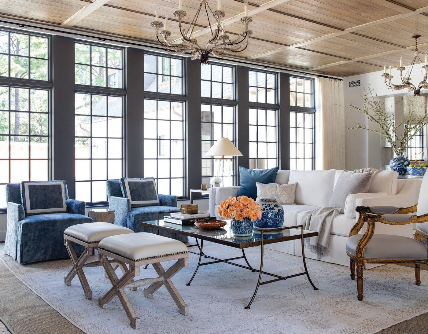 George Cameron Nash's Park Avenue sofa anchors the living room, with Bungalow Classic ottomans and Lee Industries skirted swivel chairs rounding out the mix PHOTOGRAPHED BY JULIE SOEFER