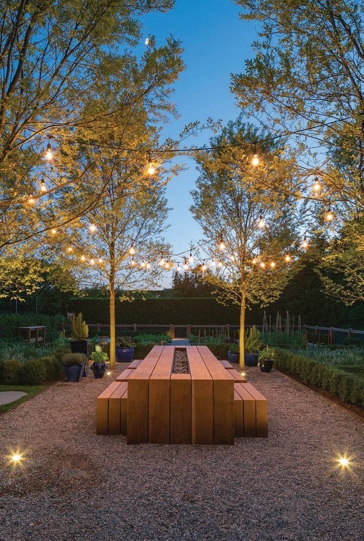 A table for outdoor dining is part of the sequence of spaces. PHOTO COURTESY OF LAGUARDIA DESIGN GROUP
