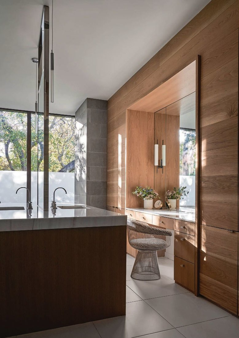 Bathed in natural light, this master bath features floor-to-ceiling windows PHOTOGRAPHED BY NATHAN SCHRODER