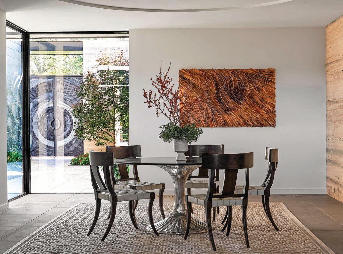 The dining room offers gorgeous indoor-outdoor views of the home. PHOTOGRAPHED BY NATHAN SCHRODER