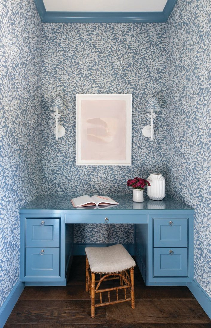 The wife's home office is lined with Romo's Kelso fabric in oxford blue, while the desk and trim sport Benjamin Moore's Smoky Azurite PHOTOGRAPHED BY JULIE SOEFER
