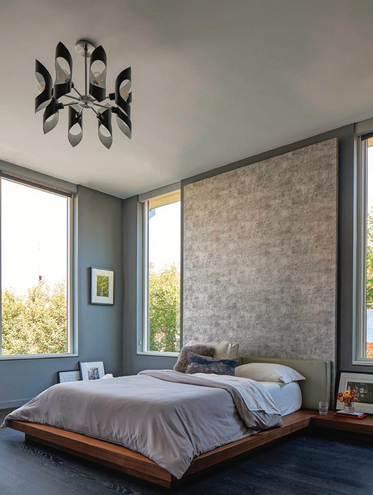 Each bedroom is a glorious respite complete with large-scale windows and cozy surroundings. PHOTOGRAPHED BY NATHAN SCHRODER