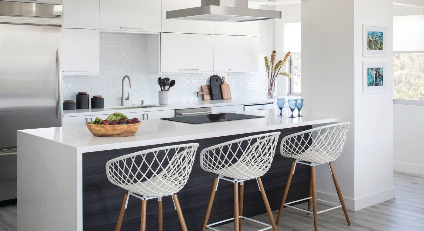 CB2's Sidera white stools adorn the kitchen counter PHOTO BY MEGHAN BEIERLE