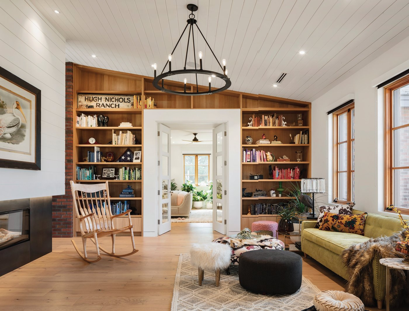 A custom rocking chair by Chase Warren Design completes the space. Photographed by Roehner   Ryan Photography