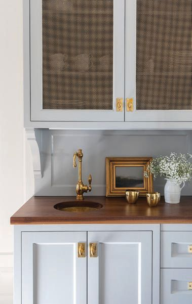 In the butler's pantry, stained walnut countertops stand out against Benjamin Moore Coventry Gray cabinets PHOTOGRAPHED BY JULIE SOEFER
