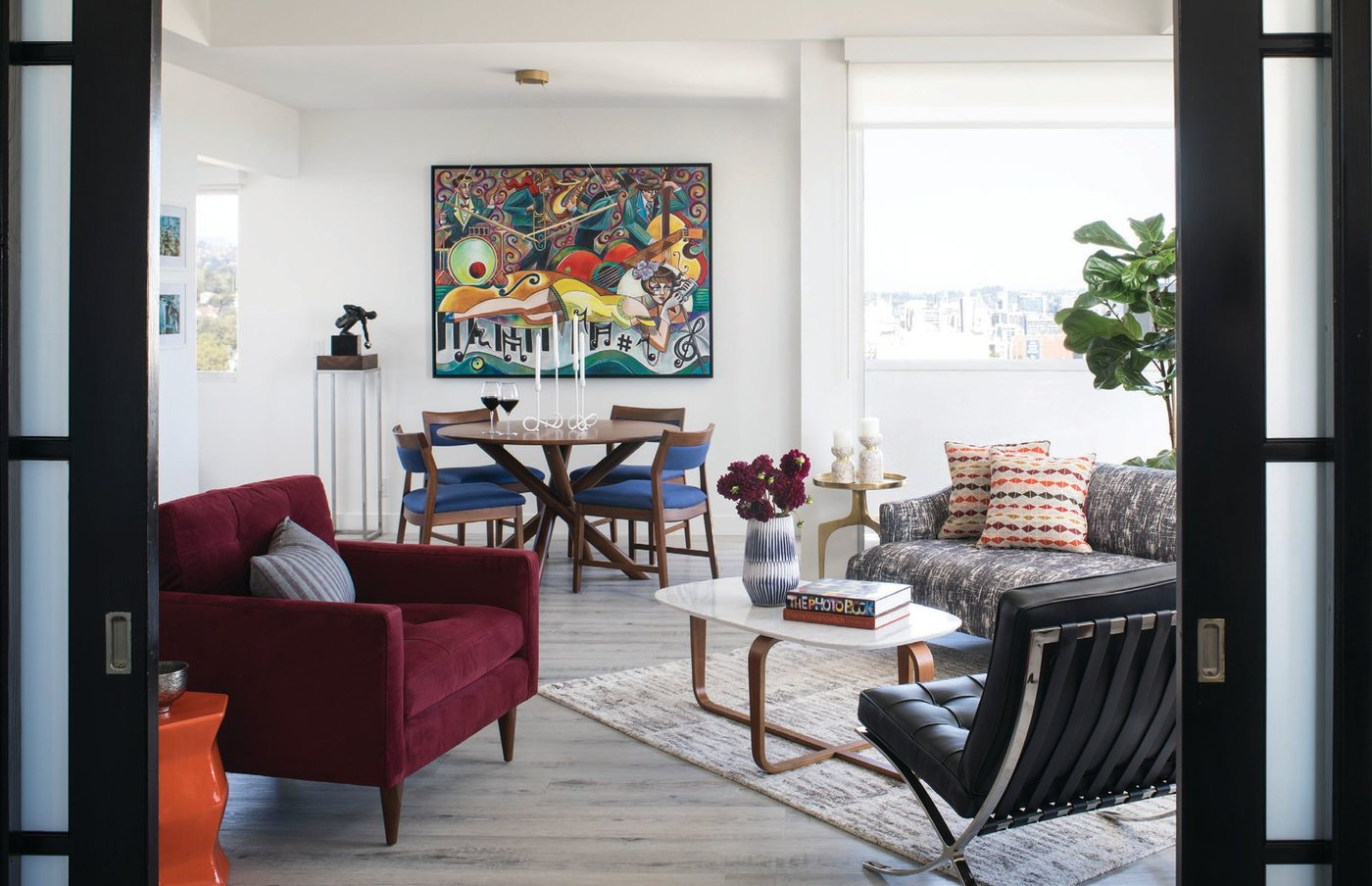 A bold painting by artist Amy Lynn Stevenson makes a statement above the dining table PHOTO BY MEGHAN BEIERLE