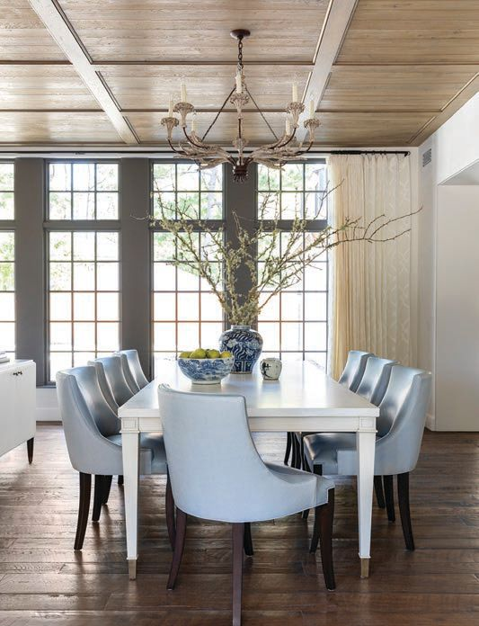 A Niermann Weeks Ferarra chandelier centers the dining room, which features a custom table and chairs from The Joseph Company. PHOTOGRAPHED BY JULIE SOEFER