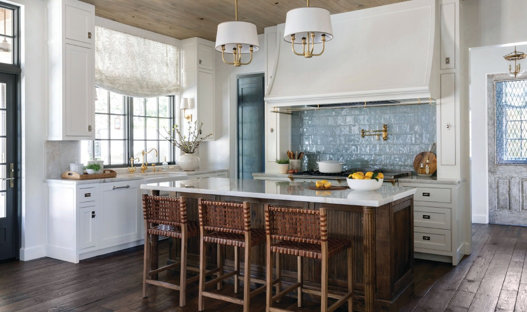 Benjamin Moore's White Dove coats the kitchen cabinets, providing a neutral frame for the pale-blue tile backsplash. PHOTOGRAPHED BY JULIE SOEFER