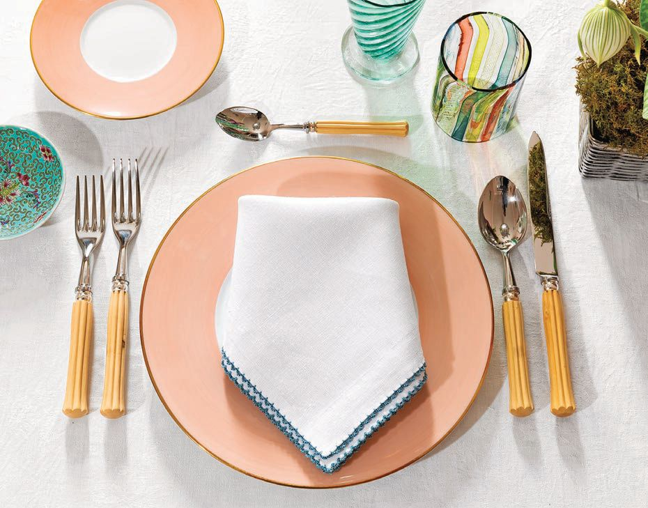 """""""I adore everything Rebecca Gardner does. She's an interior designer and event planner based in Savannah and NYC, so when COVID slowed her events business, she opened an online store selling incredibly chic products for elegant entertaining at home. I want it all, but I especially love these salmon dinner plates."""" Houses & Parties Lexington salmon dinner plates, housesandparties.com HOUSES & PARTIES PHOTO BY ADAM KUEHL"""