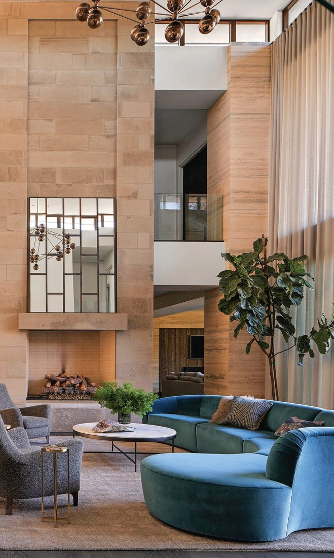 Sky-high ceilings and glass windows that abound help further expand the feel of the space PHOTOGRAPHED BY NATHAN SCHRODER